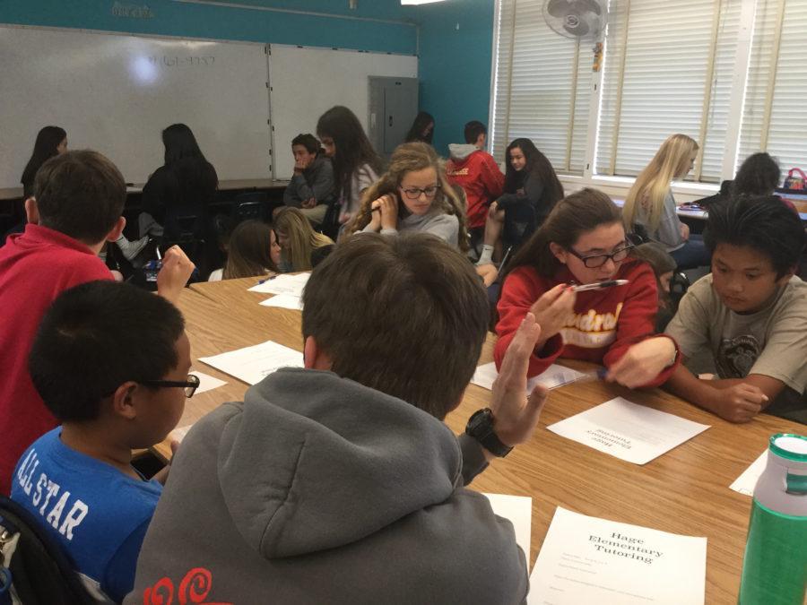 National Honor Society members tutor third grade students in math at Hage Elementary School.