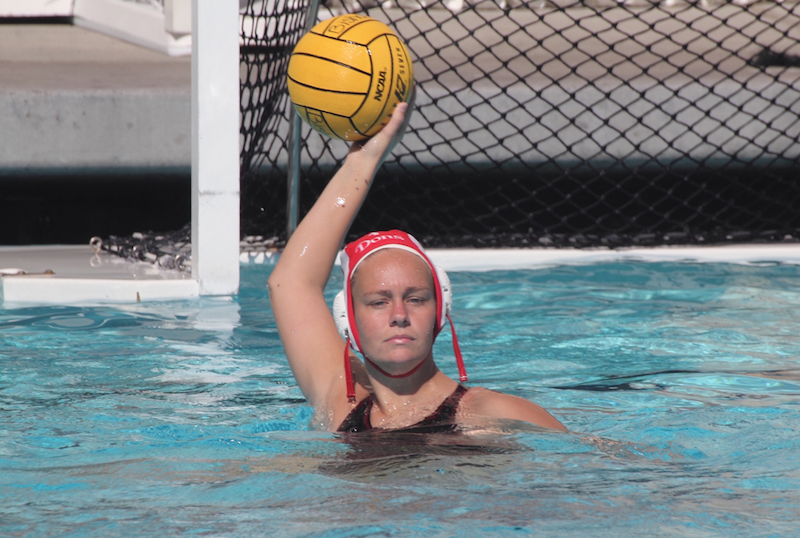 CCHS goalie Hannah Edwards '17 scans the pool for an open teammate. The Cathedral Catholic High School varsity water polo team wrapped up its season as the fourth seed of Open Division. The team ended its season by losing to Bishops High School 4-8 in the semifinal game.