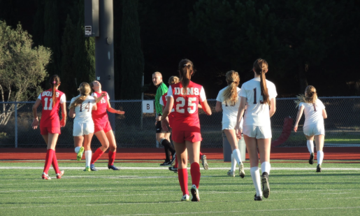 CCHS student-athlete and future Stanford University Cardinal Bianca Ferrara  '18, who wears number 11, prepares to receive the ball in a match earlier this season versus Point Loma High School. Ferrara recently signed with Stanford even though she is still a junior.