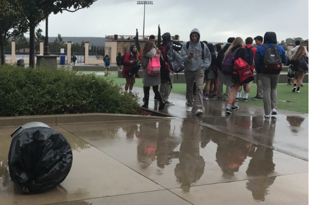 Students crowd around the knoll after school during a February afternoon rainstorm. Although rain is a major source of water in California, precipitation primarily arrives in the form of moisture. According to CCHS history teacher Mr. Don De Angelo, the fog and marine layer that rolls into California's coastal region has been historically and geologically important to the well-being of crops.