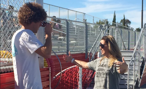 New CCHS swim Head Coach Ms. Colette Reid speaks to assistant coach Troy Marcikic before beginning practice.  The passionate head coach always makes sure everyone in on the same page and ready for a good practice.