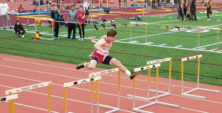 CCHS hurdler JD Carney '17 runs the last leg of the shuttle hurdle relay Saturday at the Falcon Relays invitational meet, finishing his split with a time of 16.4 seconds.