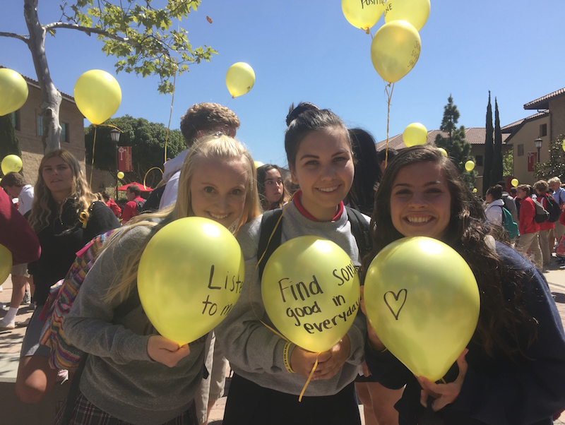Campus Ministers Sara Lackey '17, Kate Petosa '17, and Amanda Williams '17 proudly display their yellow balloons on Yellow Ribbon Day for suicide prevention to indicate that they are  willing to help wherever they are needed.