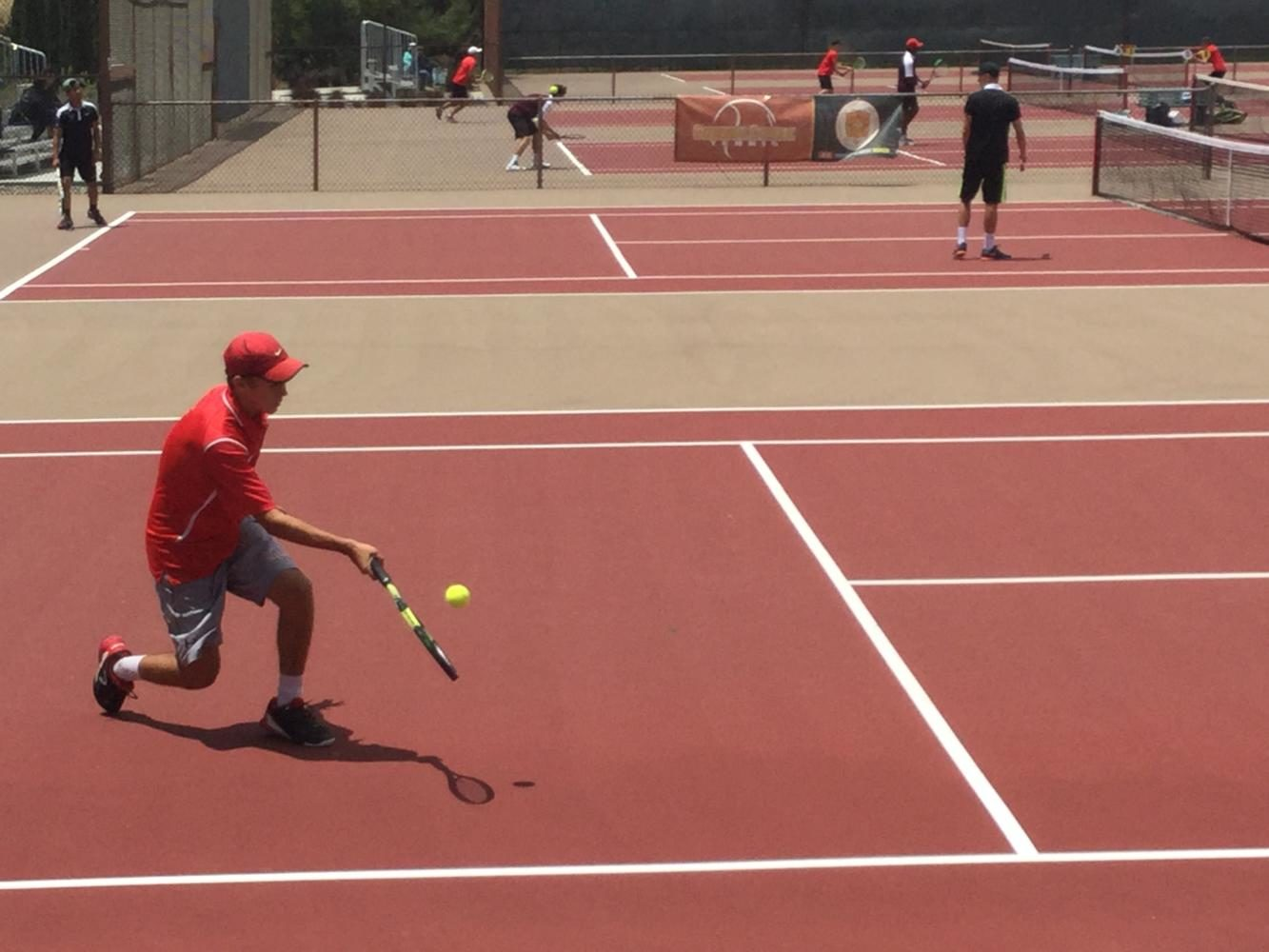 Riley Henderson '17 plays against a top player from La Jolla High School in the back draw to qualify for the 2017 CIF boy's tennis individual championships.