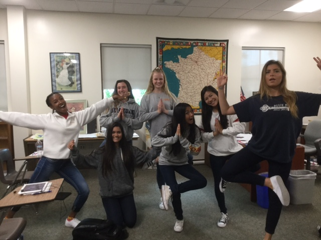 Mrs. Barbara Chaillou's AP French students take part in a spontaneous yoga session after taking a quiz.