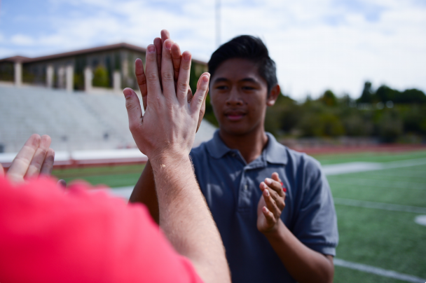 Kyle Schuster' 17 bonds with fellow classmates on the football field during their final weeks as seniors.