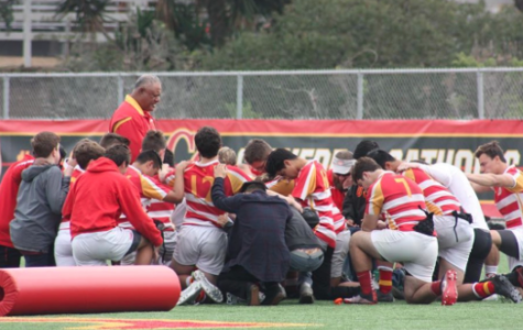 The CCHS rugby team joins in prayer after a game last season. Since then, many of the seniors seen above have left for college, but the team has high hopes for the coming season, shoe drive, and New Zealand trip.