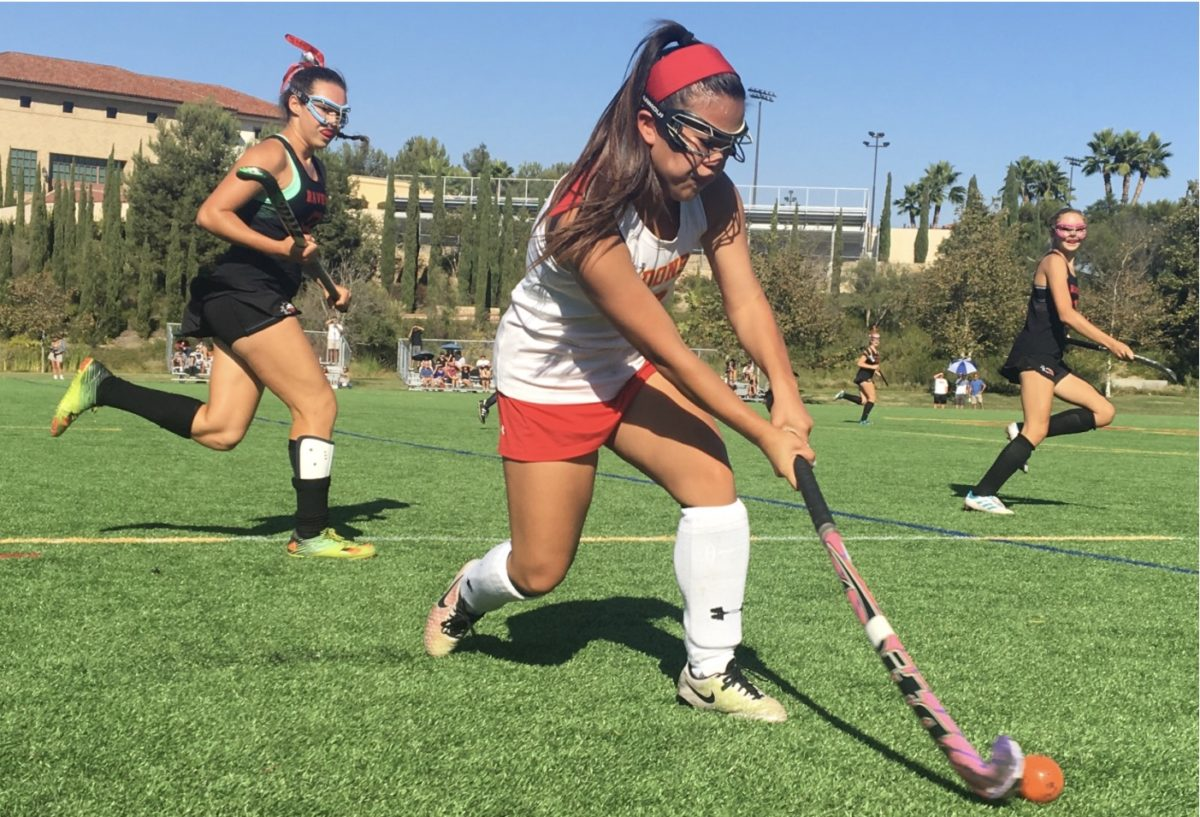 Daphne Tenuto '18 strikes the ball during the varsity field hockey home game against Canyon Crest High School last Tuesday. The Dons beat the Ravens 1-0.