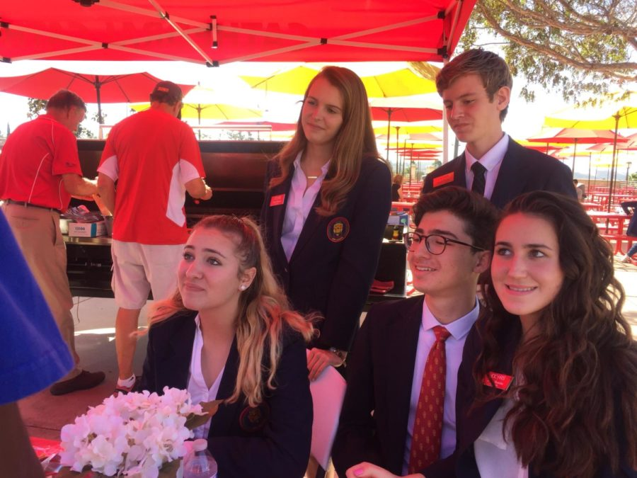 Ambassadors Ava Montali 19, Kayla Wesseln 19, Dominic Sprigg 19, Roberto Cano 19, and Janna Shakiba 19 work at Saturdays CCHS Open House, helping visitors tour CCHS campus.