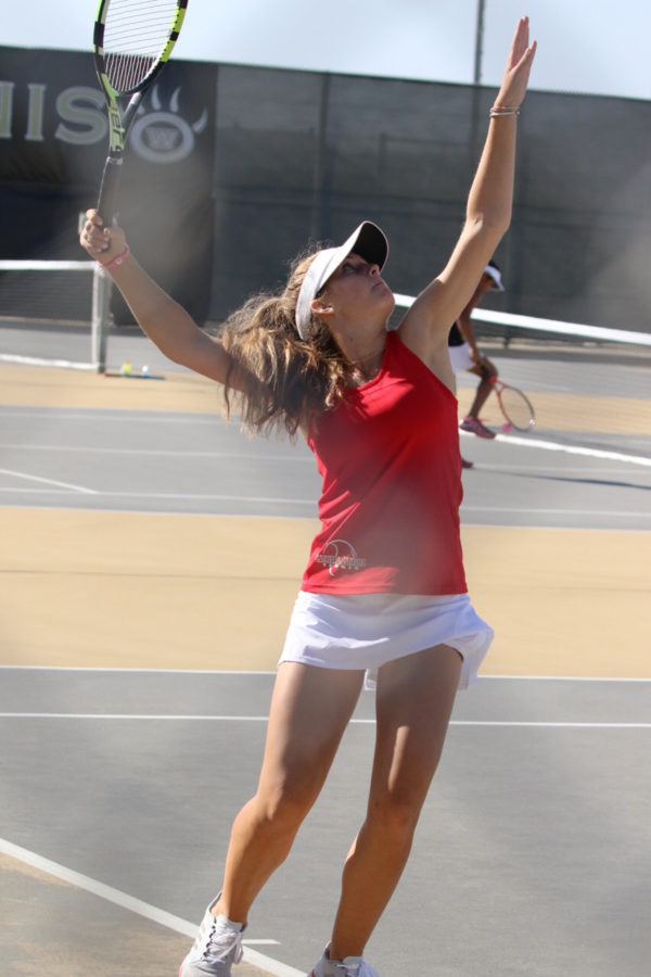 Before becoming a CIF champion, Lindsay Lynch '19 serves during a  recent match against Westview High School in which the varsity girls tennis team pulled through with a win.
