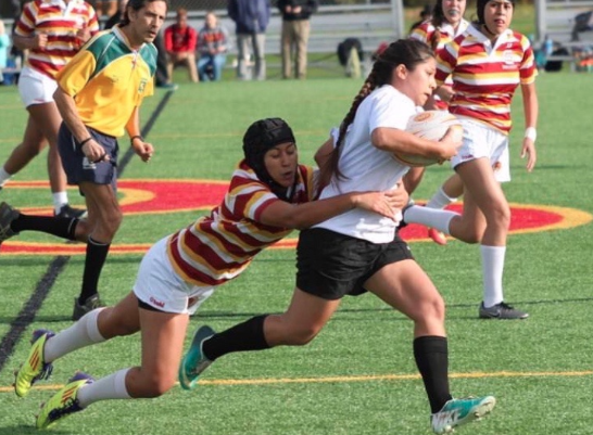 Captain Kaelene Walter '19 tackles a forward during a girls rugby game last season.