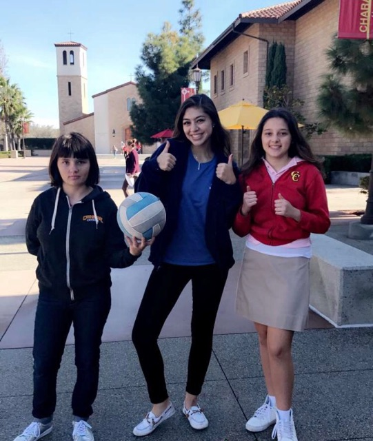 Options student Sabrina Taylor, Options mentor Halle Way '19, and and Options student Bella Pellegrino (from left to right) get ready for a volleyball game.