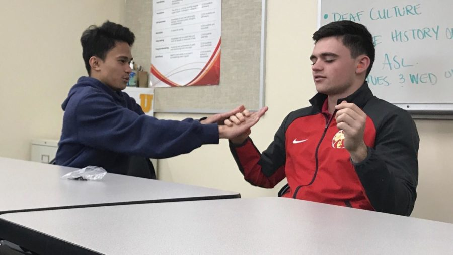 Andrew Jusayan 19 and AJ Maisano 19 commemorate National Deaf-Blind Day by communicating in the way that the deaf-blind do.