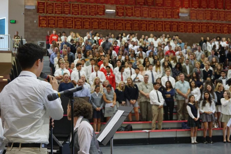 Nic Meringolo 19 sings during the Junior Unity Mass on Monday.
