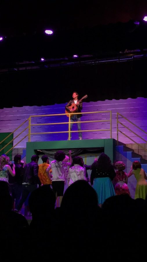 During the CCHS drama departments production of Grease, T-Bird Nic Meringolo sings Those Magic Changes while playing guitar last Friday night.