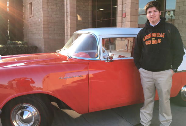 CCHS student Ryan Demers '20 poses with the 1957 Chevy his family won at the Sock Hop.