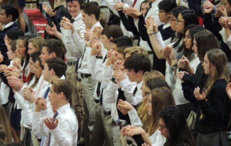 The CCHS community celebrates a school liturgy earlier this year, one of the many times students and faculty have joined together for monthly all-school Mass.