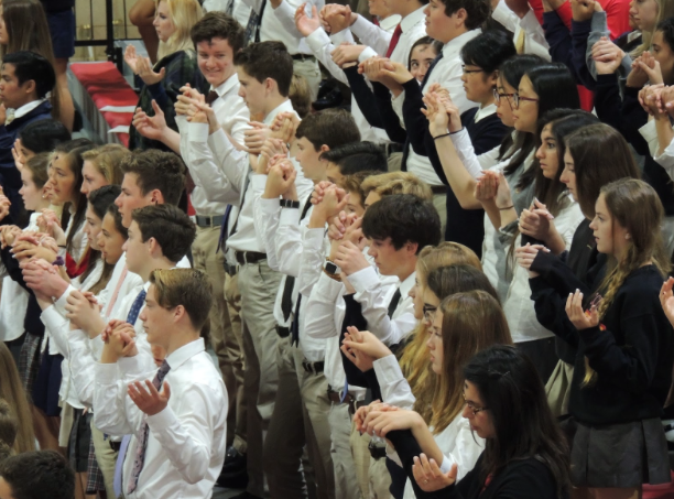 The+CCHS+community+celebrates+a+school+liturgy+earlier+this+year%2C+one+of+the+many+times+students+and+faculty+have+joined+together+for+monthly+all-school+Mass.+%0A