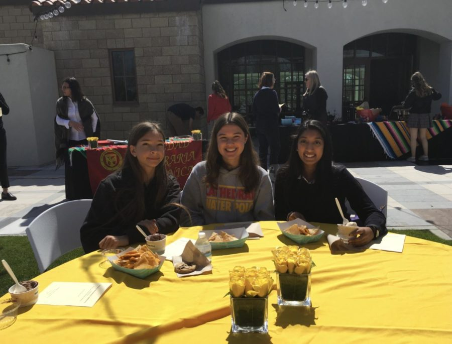 Gabrielle Charest '19, Katherine Stevenson '19, and Calista Oliveira '19 eat lunch after being inducted to the National Spanish Honors Society.