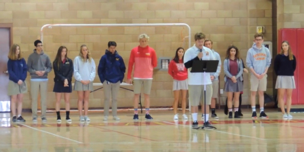 The United Student Leadership Council leads an all-school prayer service Wednesday in the Claver Center to honor the 17 lives lost during the recent shooting in Parkland, Florida, offering up prayers for the victims and families from Marjory Stoneman Douglas High School.