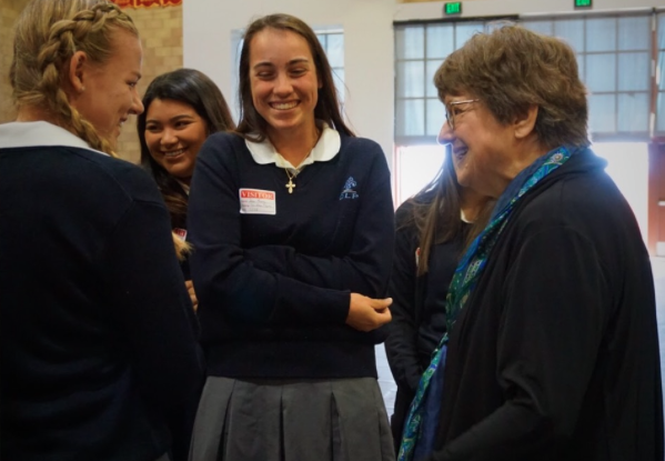 Death penalty activist and best-selling author Sister Helen Prejean (right) talks to visiting students from the Academy of Our Lady of Peace last Wednesday after her speech at Cathedral Catholic's Claver Center.