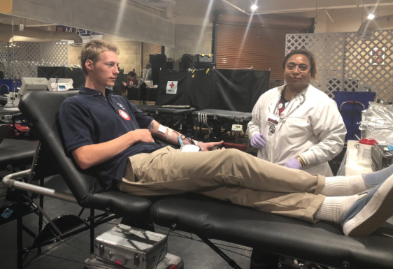 CCHS student Max Beyer '18 (left) relaxes as a blood technician draws blood from him during the school's annual blood drive yesterday hosted by the Red Cross Club. Maintaining San Diego's blood supply is critical to the recovery of cancer patients and auto accident victims.