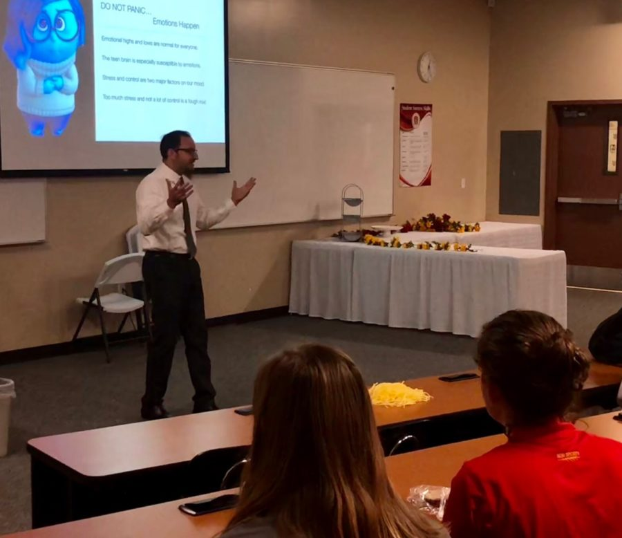 Social science teacher Mr. Frank Caro speaks to about 50 students Thursday during a presentation about depression, anxiety, and suicide during Suicide Prevention Week.