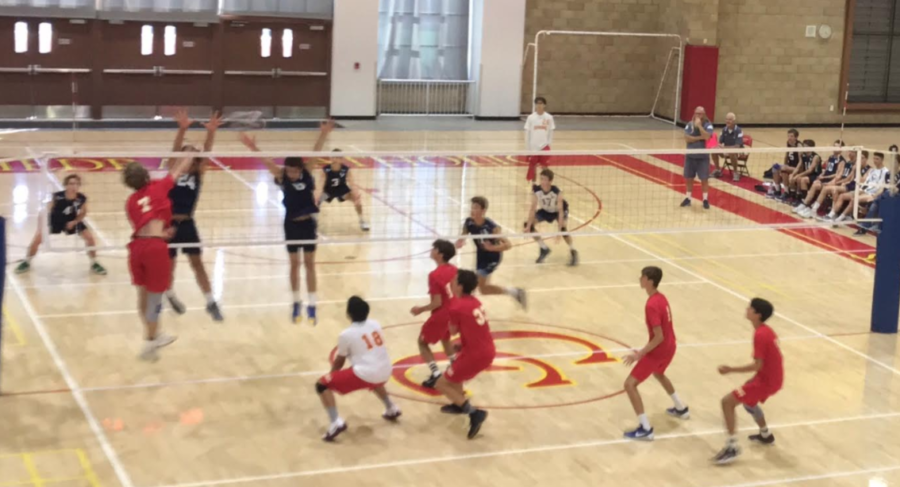 Boys varsity volleyball team captain Timmy McLoughlin 18 spikes the ball over the net, securing a point against La Costa Canyon High School on Friday afternoon during his senior night.