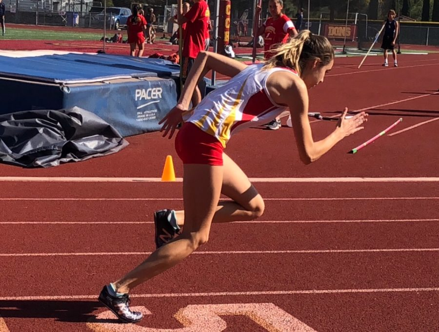 Nicole Hood '21 takes off in the 400m race Wednesday against Scripps Ranch High School, finishing second.
