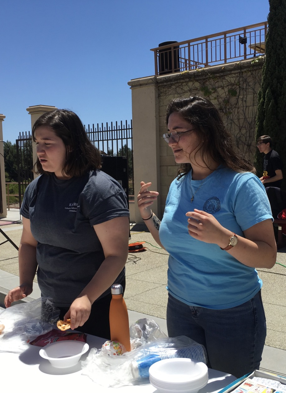 PLUS Club members Noelle Hope '18 and Isabelle Hope '18 celebrate Cinco de Mayo, complete with horchata and Mexican candy.