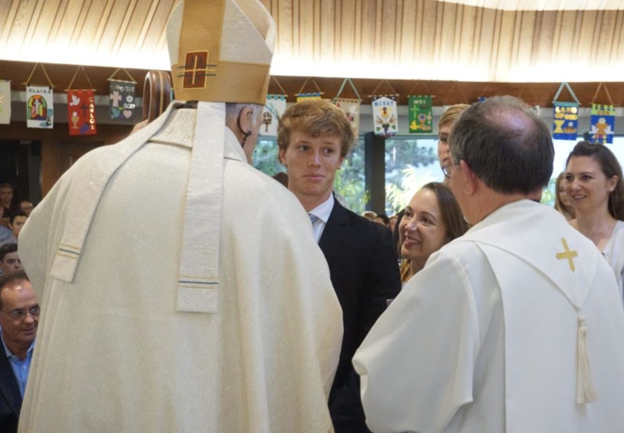 Bishop Robert McElroy shakes the hand of CCHS student Dylan Vorndran 19 after his Confirmation, a sacrament Vorndran receives alongside his teacher and sponsor Ms. Christine LaPorte.