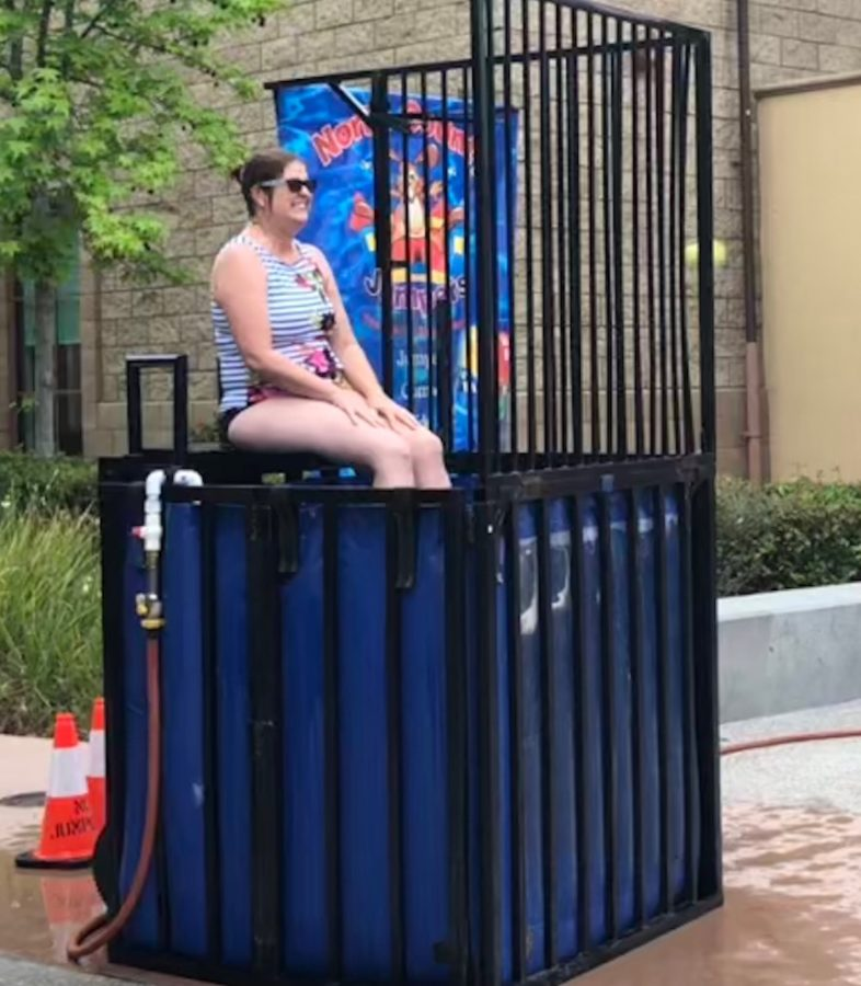 Mrs. Sandy Blackstone-Gardner, the religious studies department chair, braces herself during the ASB Spring Carnival Friday as a tennis ball flies toward the target of the dunk tank, threatening to submerge her in the cold water.