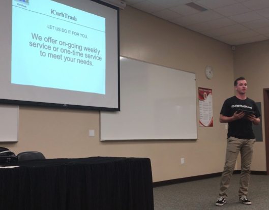Joshua Sprague'18 introduces his business proposal icurbtrash to the judges at the recent Dons Shark Tank event.