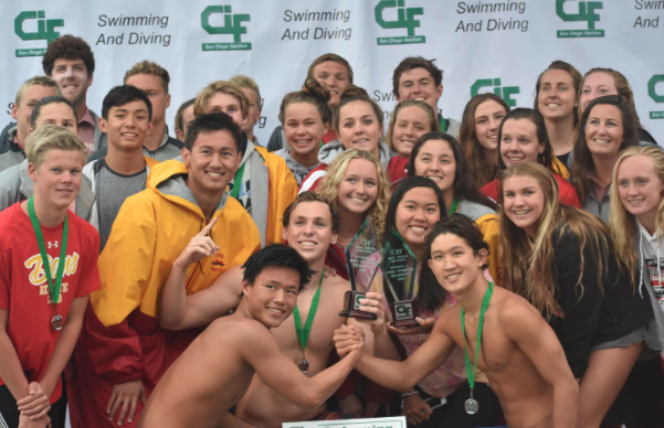 Members+of+the+Cathedral+Catholic+High+School+varsity+boys+and+girls+swim+team+display+medals+after+winning+CIF.%0A