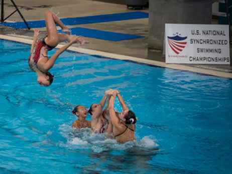 Alexandra Suarez '18 and her team, the Santa Clara Aquamaids, perform a lift at the 2018 U.S. Junior National Synchronized Swimming Championships in Lewisville, Texas, where the team won gold.