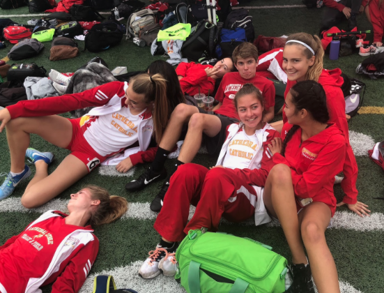 Cathedral Catholic High School track athletes take a break after a recent meet. They have each excelled in every event of the season, making their coach proud as the boys won CIF, and the girls finished just short.