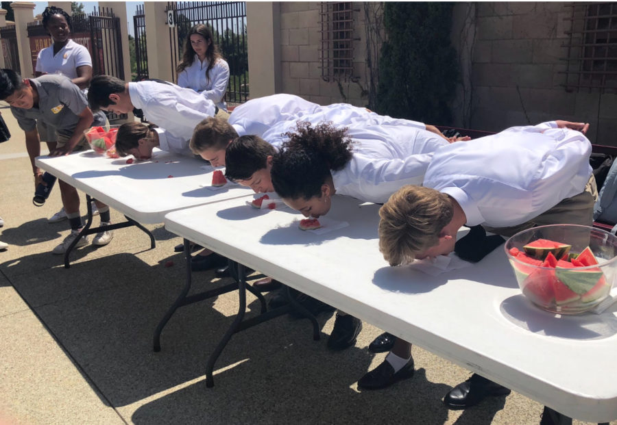 Five freshmen compete Wednesday in a lunchtime watermelon eating contest put on by ASB members in order to welcome the class of 2022 to CCHS during their first week as high schoolers.