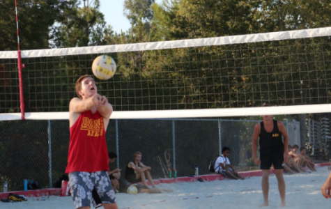 During the last few minutes of a nail biting match, Nathan Nash '20 bumps the ball to brother Ben Nash '19, who spiked it for a point. The brothers are partners on the boys varsity sand volleyball team, which lost Thursday afternoon 3-2 to Mission Bay High School.
