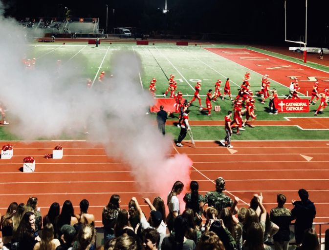 Led by Los Locos, the spirited CCHS student section, students celebrate after the Dons defeat Olympian High School 36-6 on Friday. The Dons encouraged the varsity football team by wearing camouflage along with their school spirit.