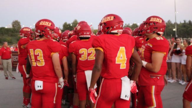 The Dons varsity football team lines up before facing Olympian High School Friday at Manchester Stadium. The Dons blew out Olympian 36-6 as CCHS proved its dominance throughout the game.