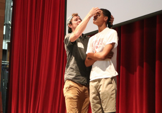During Thursday's freshmen retreat, guest speaker Jamie Cleaton began his talk with a game that would eventually be revealed as a prank, placing a penny on the forehead of an unsuspecting freshmen. The retreat mainly took place in the theater, and it consisted of small group discussions, faith talks, praise and worship, and class bonding games.