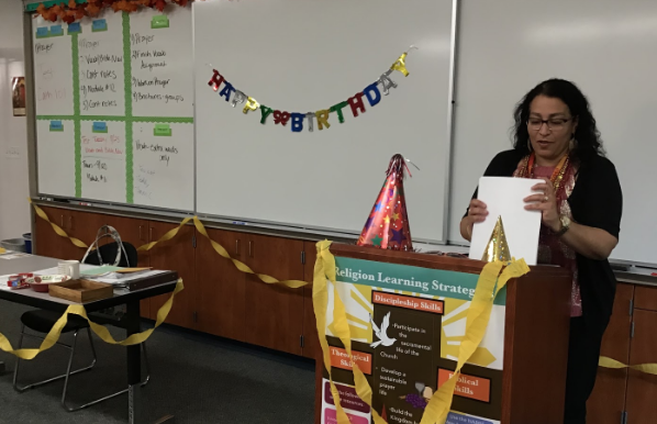 Mrs. Bacich, Catholic Faith 9 and Innovations teacher, stands in her classroom, which was decorated by Miss Laporte, Mrs. LoCoco, and Mrs. Lonergan in honor of her birthday.
