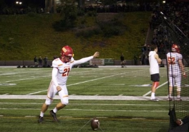 Dons' kicker Dean Janikowski '19 practices his kick on the sideline of the Holy Bowl during the third quarter last Friday night. Dons beat the Saints 34-14.