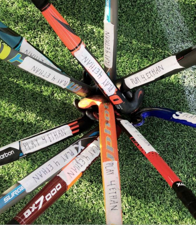 During the game Friday against Archbishop Mitty High School, the varsity field hockey team supported teammate Emma Olson '21, who recently lost her brother, by donning its sticks with tape reading