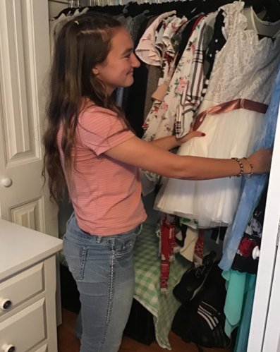 Marie Temprendola '19 examines previous homecoming dresses, while searching for neon and white to match this year's theme.
