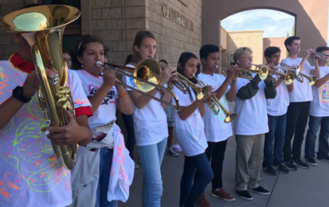 Members of the CCHS band and orchestra, dressed in neon for this year's homecoming theme, welcome students into the Claver Center before the homecoming rally. The CCHS drumline, also known as the Drummin' Dons, performed during the first few minutes of the rally to pump up the students.
