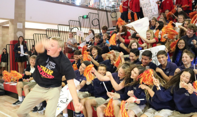 Los Locos leader Tommy Gruwell '19 leads visiting eighth graders in the wave during the Dons Day rally, an event focused on welcoming future Dons of the class of 2023 to the CCHS campus for the day.