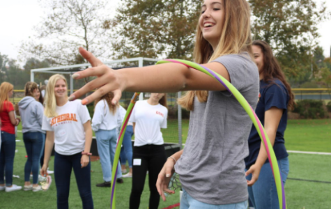 Jackie Schnell '21 reaches for the hold of another group member during a team bonding game at the girls sophomore retreat this past Thursday. The day was filled with games, talks, and small group time, all organized and led by senior Campus Ministers.