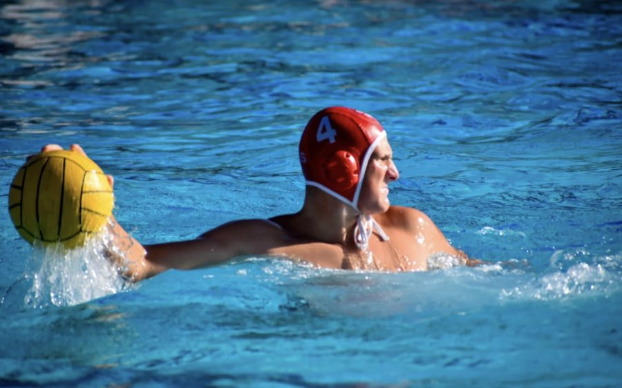 A dominant player on the Cathedral Catholic water polo team, Tommy Gruwell prepares to shoot in a game against tough rivals the La Jolla Vikings.