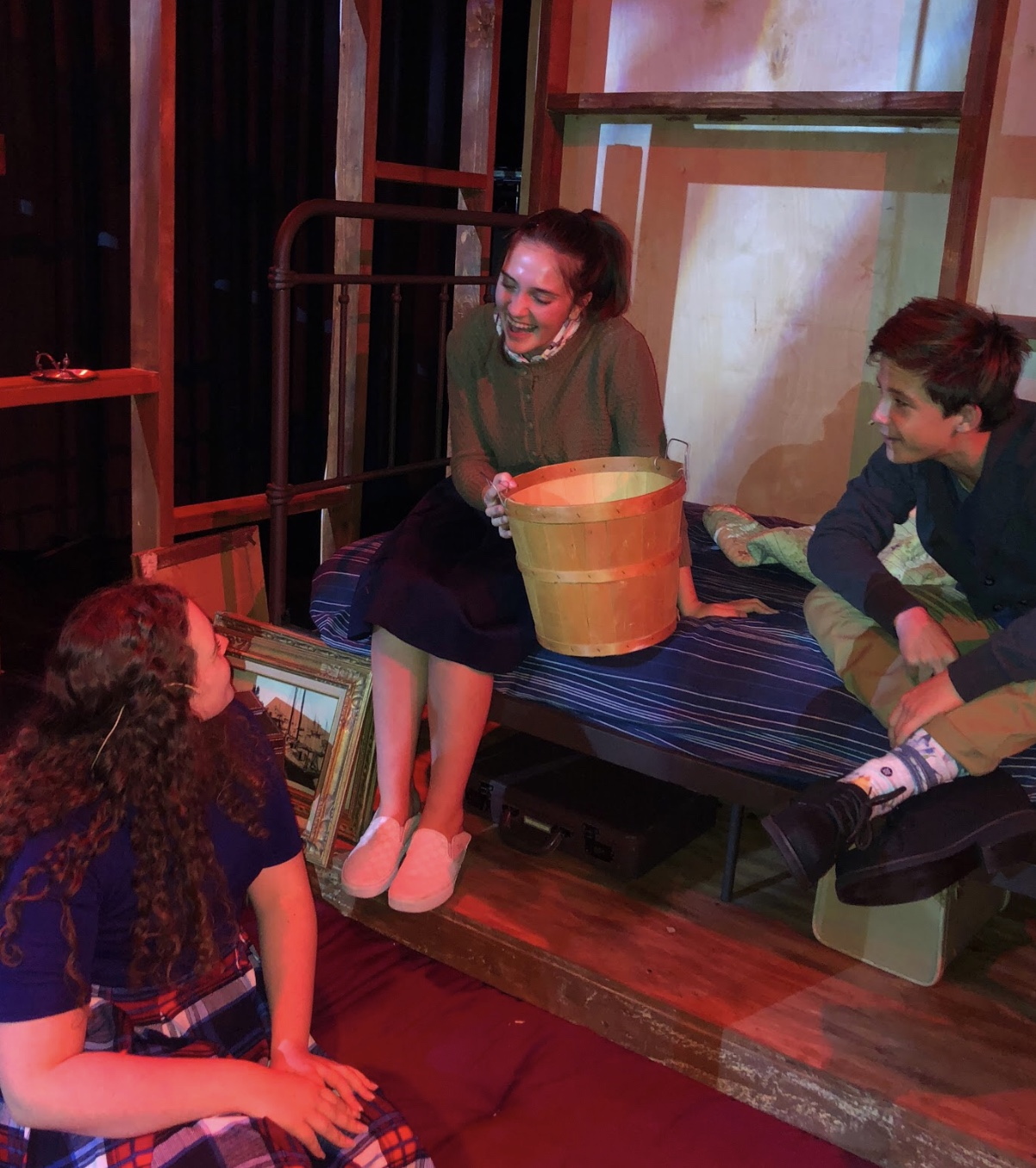 Kelsey Lyons '20, Mia Devins '20, and Maximo Nichols '22 rehearse a scene as their three characters have a conversation in Anne's room, helping to lighten the mood of the play as a whole.